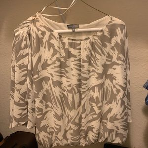 Flutter sleeve , blousy top , easy to wear .